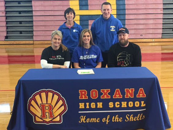 Roxana senior Braeden Lackey recently signed a letter of intent to play volleyball at Lewis and Clark Community College. She is flanked by her parents, LC coach Johnna Kinney and Roxana coach Mike McKinney.